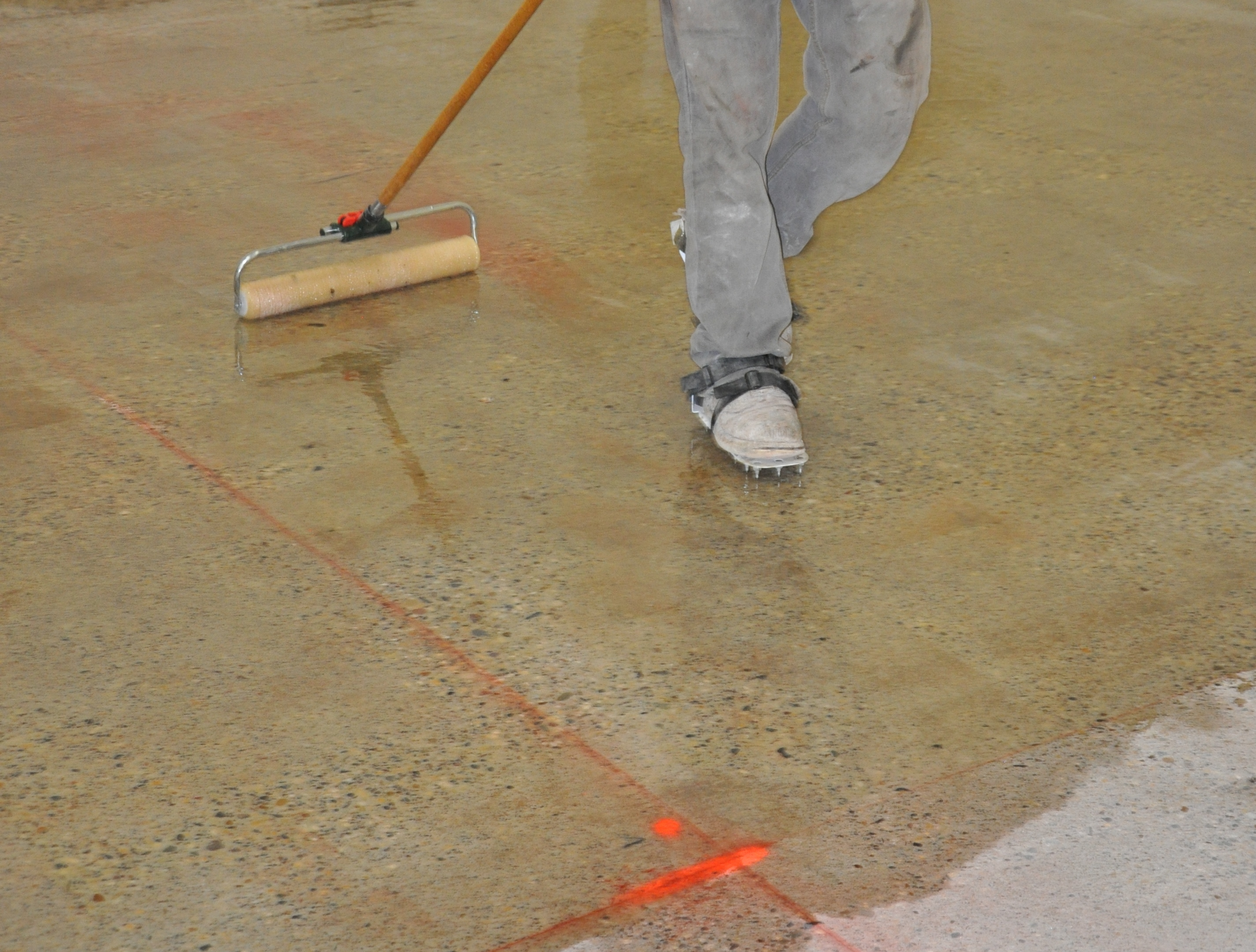 Floor leveling compound over tile